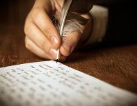 Mão escrevendo